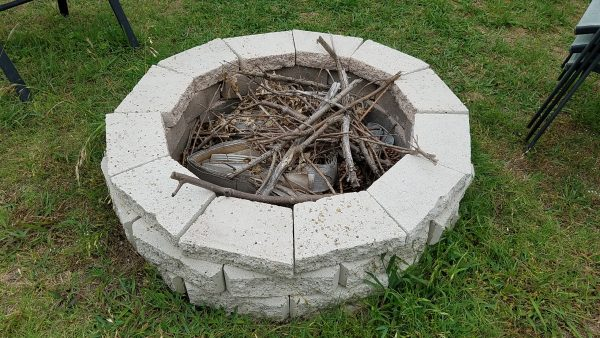 Build a fire pit in your backyard for summer evenings full of memories ... and survival skills!