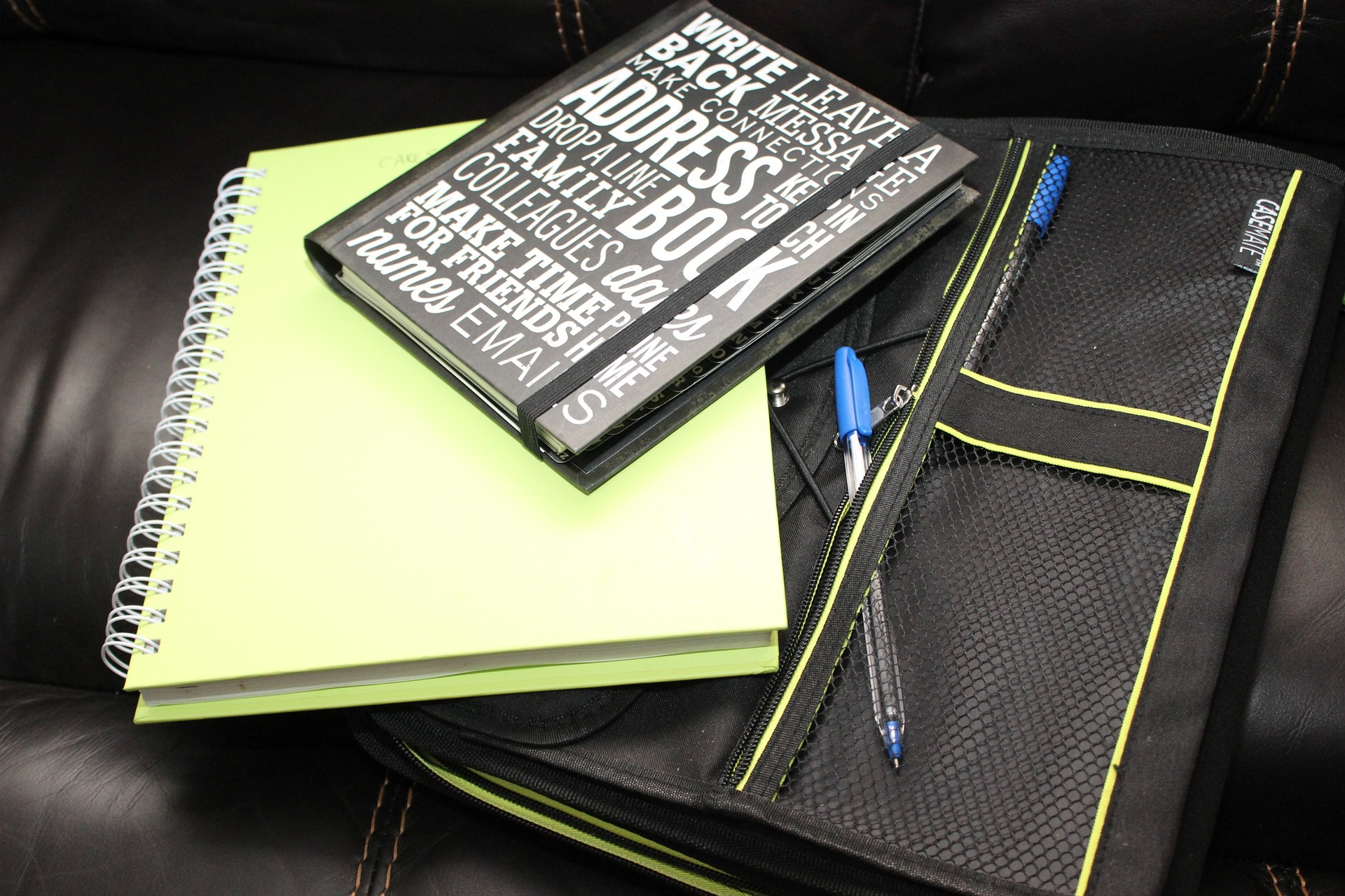An address book, notebook, and cloth binder