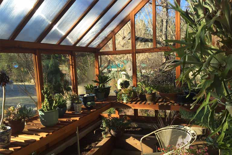 Tips On Designing A Great Greenhouse To Attach To Your Home