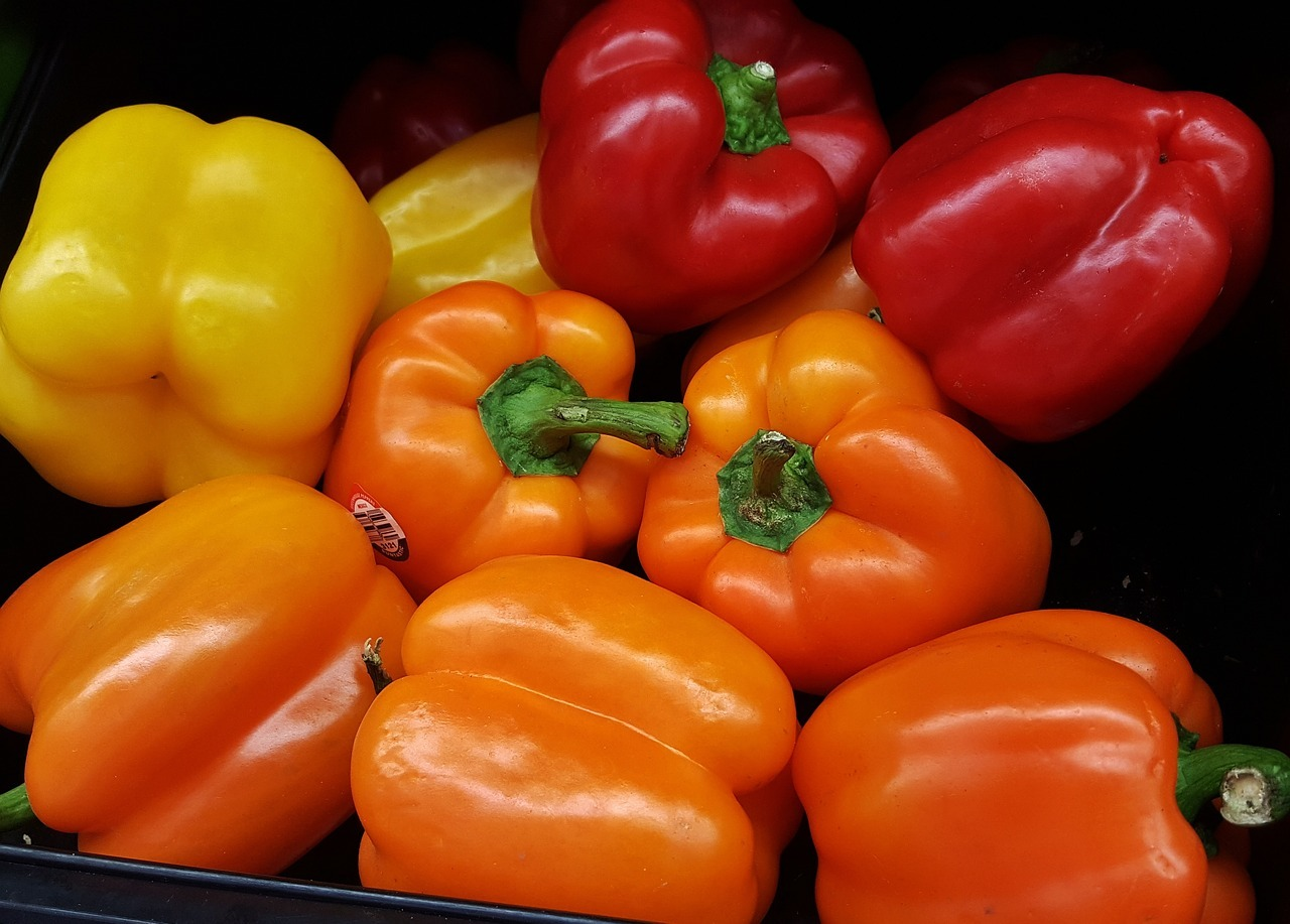 mixed yellow, orange and red bell peppers