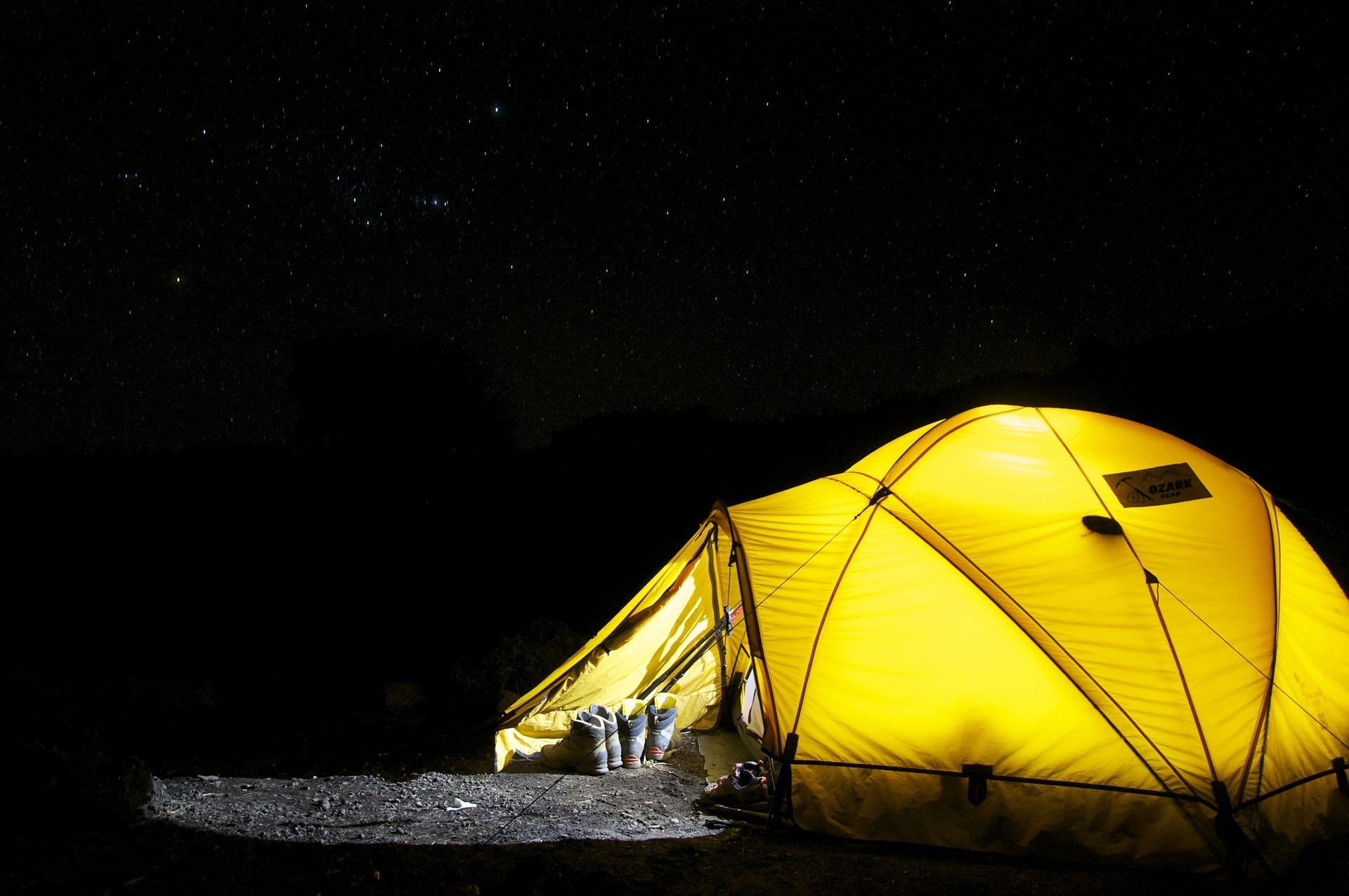 Camping tent placed underneath the stars