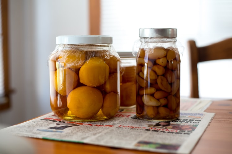 Canned goods inside the jars and a newspaper