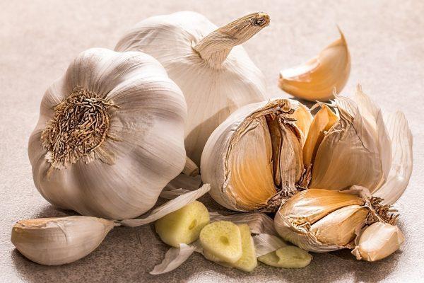 cut garlic sitting on a table